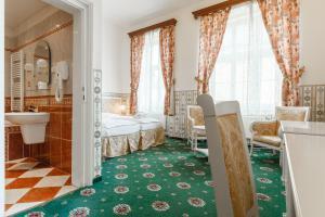 Een badkamer bij Hotel Klarinn Prague Castle