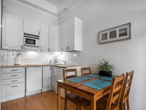 A kitchen or kitchenette at Citykoti Downtown Studios