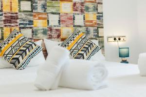 Cama o camas de una habitación en Ático abuhardillado en el centro