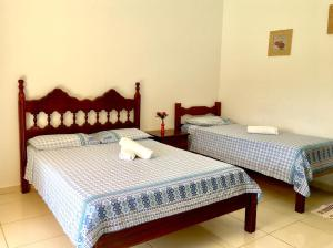 A bed or beds in a room at Recanto do Teimoso