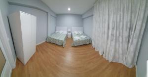 Un ou plusieurs lits dans un hébergement de l'établissement el principe