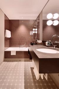 Ein Badezimmer in der Unterkunft Hotel Walhalla