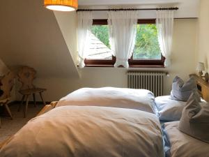 A bed or beds in a room at Gasthof Adler