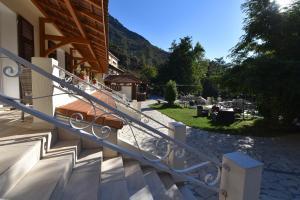 Balcon ou terrasse dans l'établissement Hotel Arena restaurant le Refuge