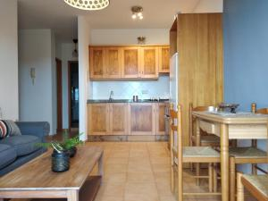 A kitchen or kitchenette at El Sitio
