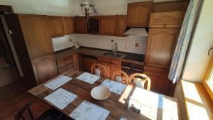 A kitchen or kitchenette at Chalupa Lipno