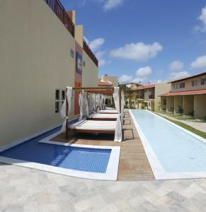 The swimming pool at or close to Flat Solar Água Pipa Prime