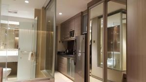 A kitchen or kitchenette at Prime Asia Hotel