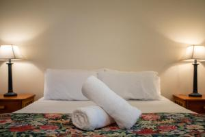A bed or beds in a room at Seaview At Trinity
