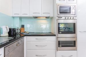 A kitchen or kitchenette at Seaview At Trinity