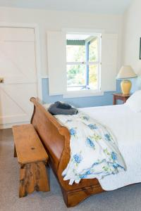 A bed or beds in a room at Akaroa Streamside Cottage