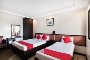 OYO 394 Tagaytay Haven Hotel - Mendezにあるベッド