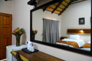 A bed or beds in a room at Cest Si Bon Hotel