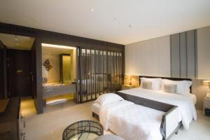 A bed or beds in a room at The Anvaya Beach Resort Bali