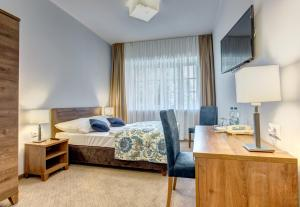 A bed or beds in a room at Hotel Książ