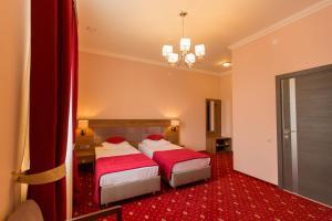 Кровать или кровати в номере BELLHOTEL