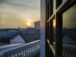 A balcony or terrace at Eva Homestay