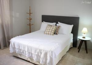 A bed or beds in a room at Hostel Luz da Lua