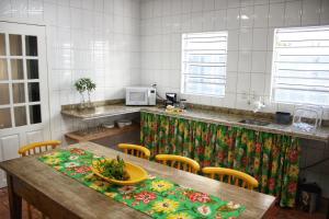 A kitchen or kitchenette at Hostel Luz da Lua