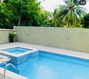 The swimming pool at or near ExquisiteSuitesJA@ManorPark