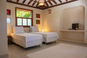A bed or beds in a room at Pousada Erva Doce