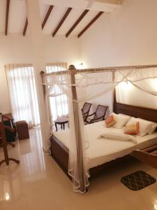 A bed or beds in a room at Prince Villa