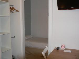 Un ou plusieurs lits dans un hébergement de l'établissement Hôtel Les Alizés