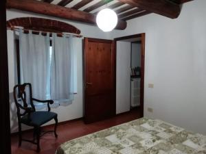 Letto o letti in una camera di Appartamento da Coco'