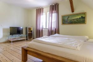 Ein Bett oder Betten in einem Zimmer der Unterkunft SchlafGut Gmelin
