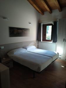 Cama o camas de una habitación en Hotel Rural El Molinar