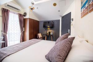 A bed or beds in a room at Q Loft Hotel1929@Chinatown (SG Clean, Staycation Approved)