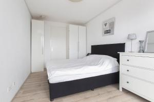 A bed or beds in a room at MyCityLofts - Calypso