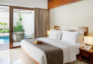 A bed or beds in a room at The Magani Hotel and Spa