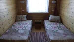 A bed or beds in a room at Guest House Nadezhda
