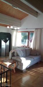 Ein Sitzbereich in der Unterkunft Das Haus am Wald Ferien- & Apartmenthaus