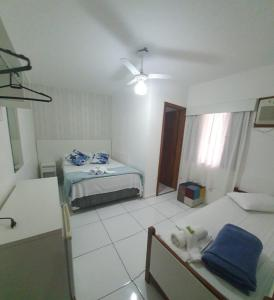 A bed or beds in a room at Pousada Mar Azul