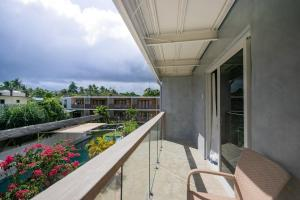 A balcony or terrace at Reef Beach Resort