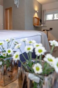 Ein Bett oder Betten in einem Zimmer der Unterkunft Hotel Luise-Luisenhof