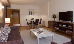 Zona de estar de Altis Suites