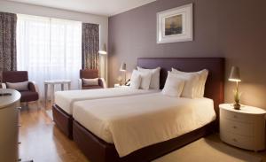 Cama o camas de una habitación en Altis Suites