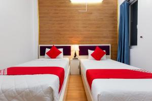 A bed or beds in a room at Little Hanoi Hostel