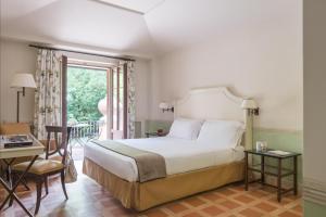 Cama o camas de una habitación en QC Termeroma Spa and Resort