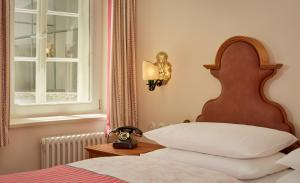 A bed or beds in a room at Hotel Goldener Hirsch, a Luxury Collection Hotel, Salzburg