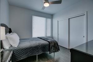 A bed or beds in a room at SoBe Denver 30 Day Rentals