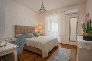 A bed or beds in a room at Apartments & Rooms Perla