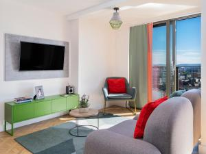 A television and/or entertainment center at Church Street by Supercity Aparthotels