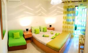 Krevet ili kreveti u jedinici u objektu Beachfront apartments Kate