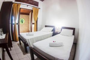 Cama ou camas em um quarto em Villa del Mar Praia Hotel