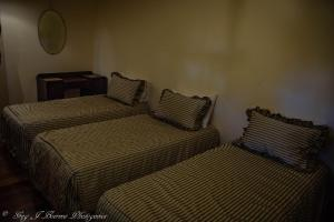 A bed or beds in a room at The Hidden Gem