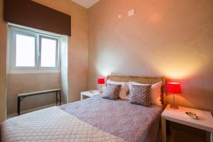 A bed or beds in a room at DuplexduBocage